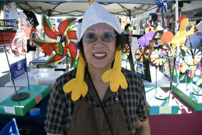 A woman at the 2009 fair gets into the spirit of things with a chicken hat.