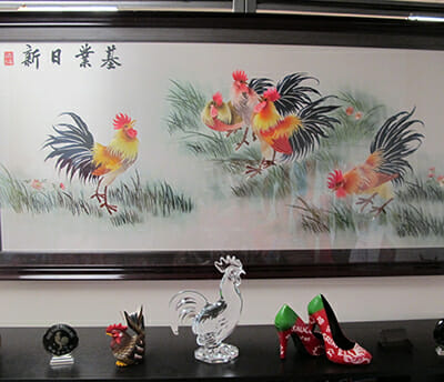 The room contains rooster statues, sriracha high heels and everything else rooster.