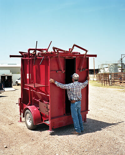 Bill Coble, Webb County Tick Supervisor, opens a portable spray-dip machine used for treating cattle with a tickicide.