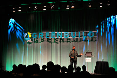 Ron Finley, L.A. gardener and fashion designer for athletes, speaks at one of Greenbuild's Master Series sessions. / Courtesy Greenbuild Expo.