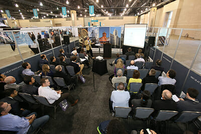A speaker presents in one of the conference's Education Labs located on the expo floor. / Courtesy Greenbuild Expo.