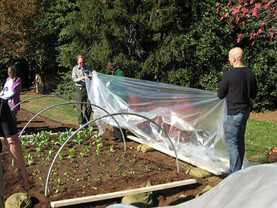 Kass helps assemble high tunnels for the White House garden. / Courtesy the White House.