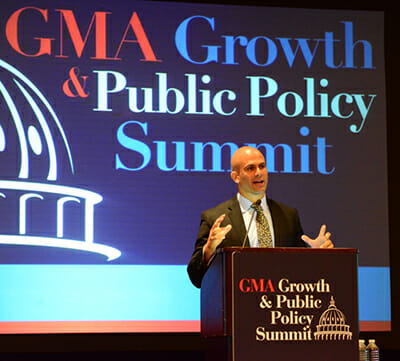 Sam Kass speaking at the Grocery Manufacturers Association Growth and Public Policy Summit. / Courtesy the White House