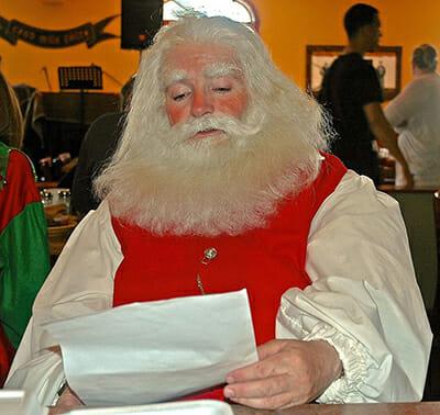 Custom Wig Company's Santa Tom wearing a yak-made wig and beard. / Courtesy Tom Sheerin.