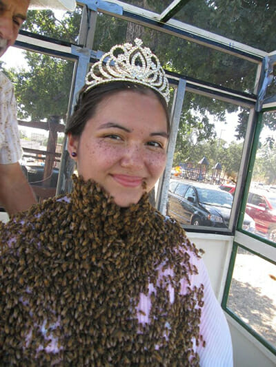 Austin sometimes demonstrates a bee beard, allowing thousands of the insects to crawl on her neck and face, to convince audiences of the docile nature of honeybees.