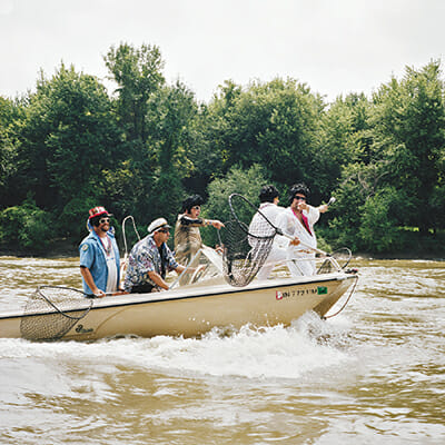 A group of fishermen ride out to get a spot on the river.