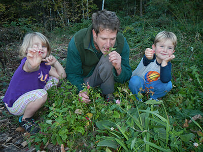 For Sam Thayer's children Myrica and Joshua, foraging is an ordinary part of their day and diet. Here, they gather strawberry spinach for lunch.