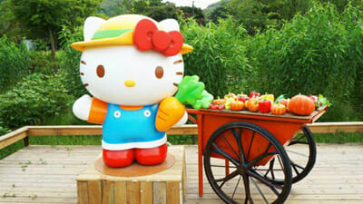 A standee of the cat in a farmer-styled outfit at the entrance.