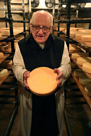 Brother Alberic with his handmade cheese.