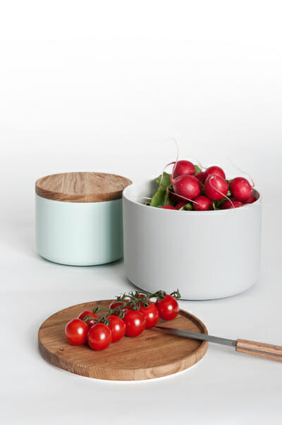 Multipurpose ceramic containers double as cutting boards.