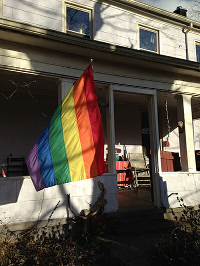 A rainbow flag flies in front of Gael and Charoula's Ohio farmhouse. / Courtesy Bill Schaffer.