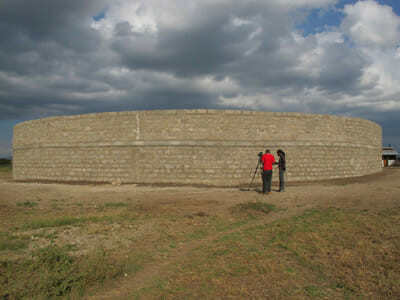 The masonry wall was built from locally-sourced materials.