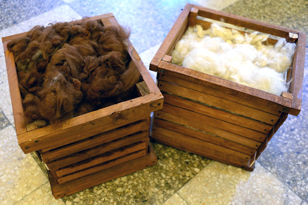 A box of fiber and fleece at Fountain House in New York City waiting to be spun.