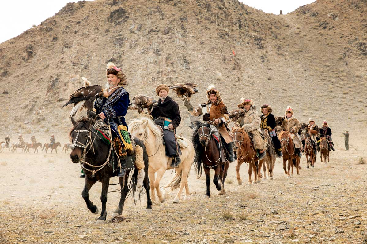 A group of Kazakhs from the Altai Mountains set off on the 120-mile trek to the Golden Eagle Festival in Ulgii, where the men and their birds will compete in tests of speed, agility, and accuracy.