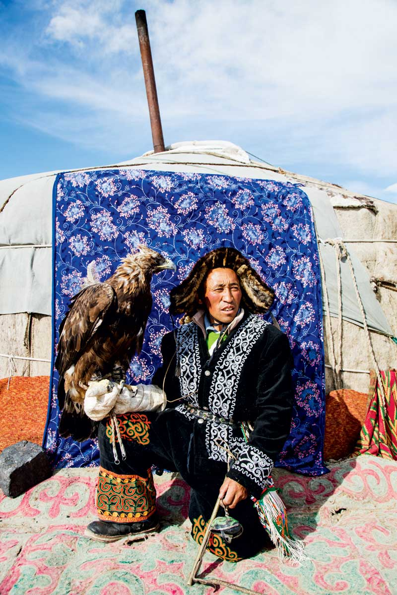 The terrain may be bleak, but the falconers' clothing and yurts - including those of Jaidarkhan Jantekei - are quite the opposite. Many Kazakhs live semi-nomadically, moving their campsites according to the seasons and residing in permanent houses only as winter descends.