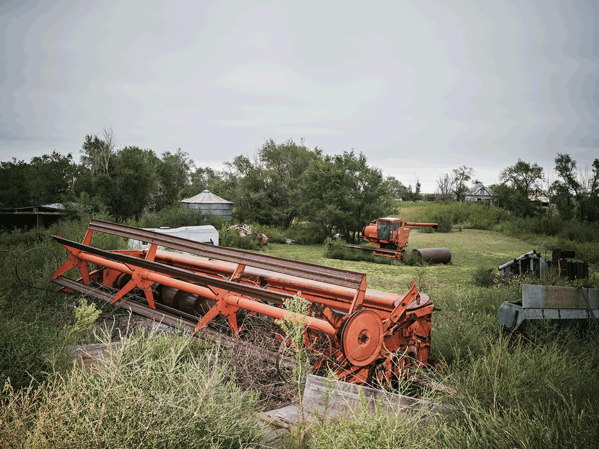 Abandoned farm equipment rusts in a Nicodemus field.