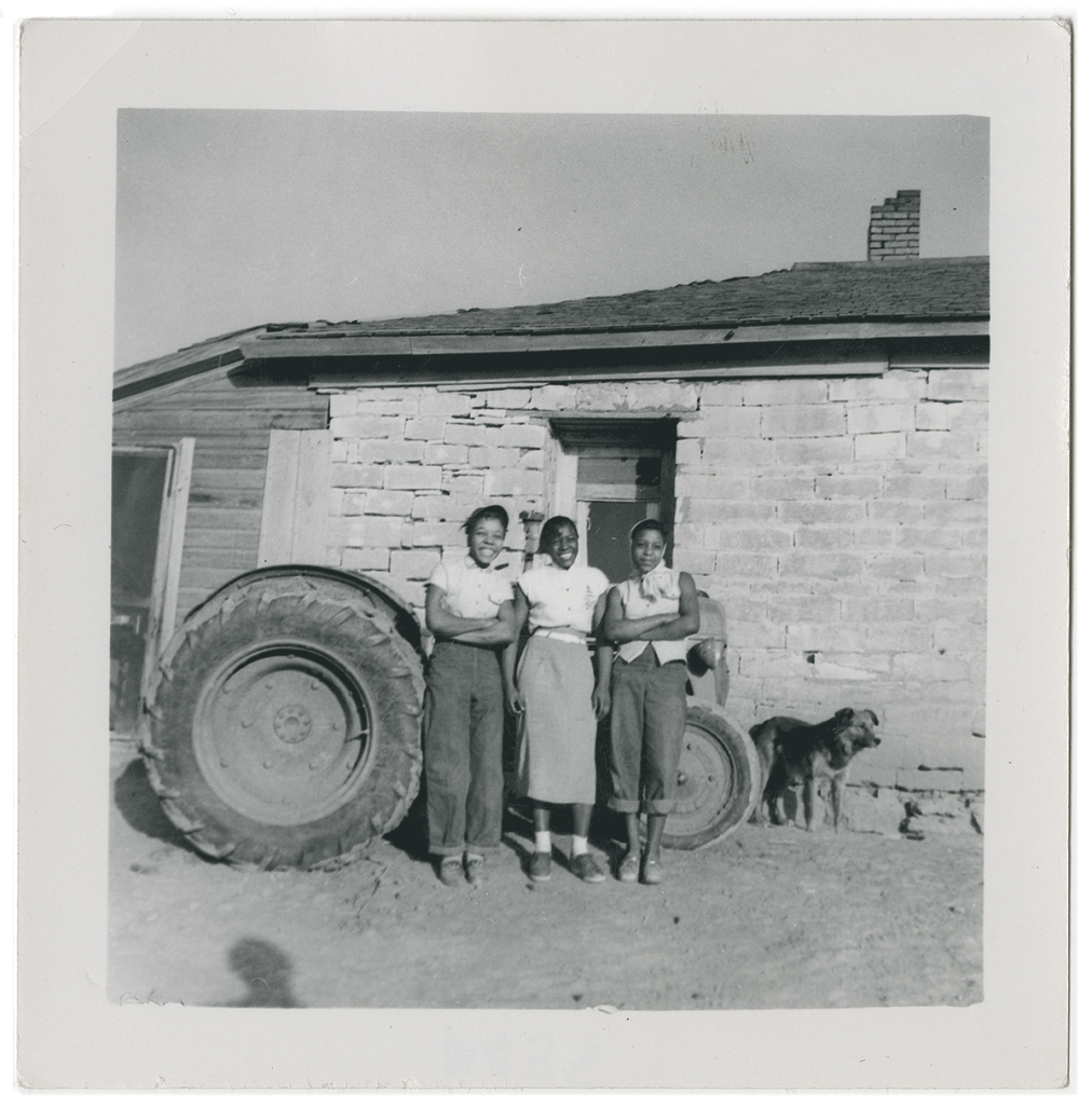 This shot of three young women on a Nicodemus farm was likely taken in the 1940s.
