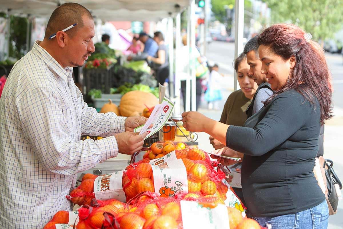 Shopping at the Central Avenue Farmer's Market in Los Angeles.