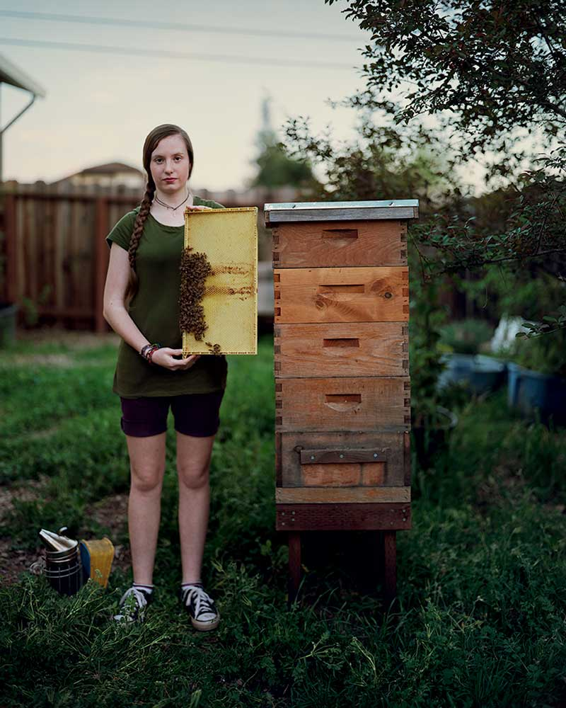 In April of this year, Clara Brockman, 11, posed with one of the three Langstroth beehives she maintains under the direction of the Claycord County 4-H club in California.