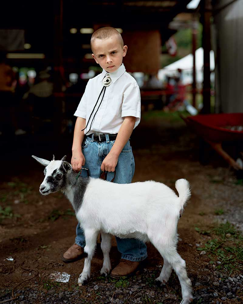 At the 2009 Tazewell County Fair in Virginia, 4-H participant Levi Parks, then 7, showed his fainting goat, Hildie.