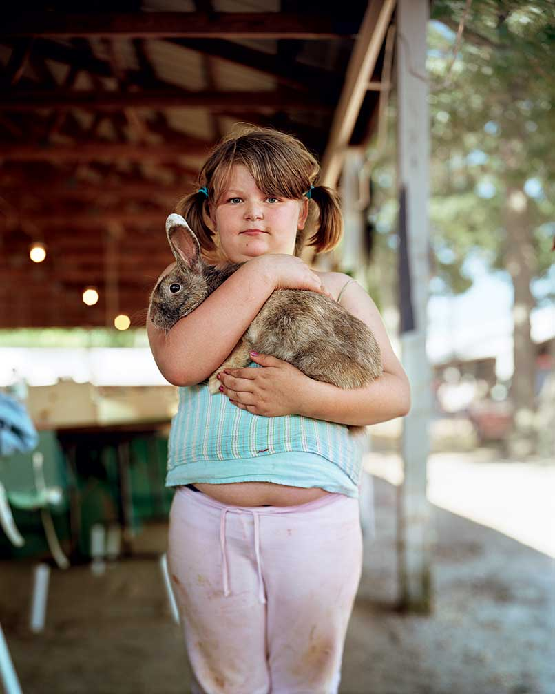 Elisa Jo Puleo, then an 8-year-old 4-H girl, cradled her Argente Brun rabbit at the 2007 fair in Cumberland County, NJ.