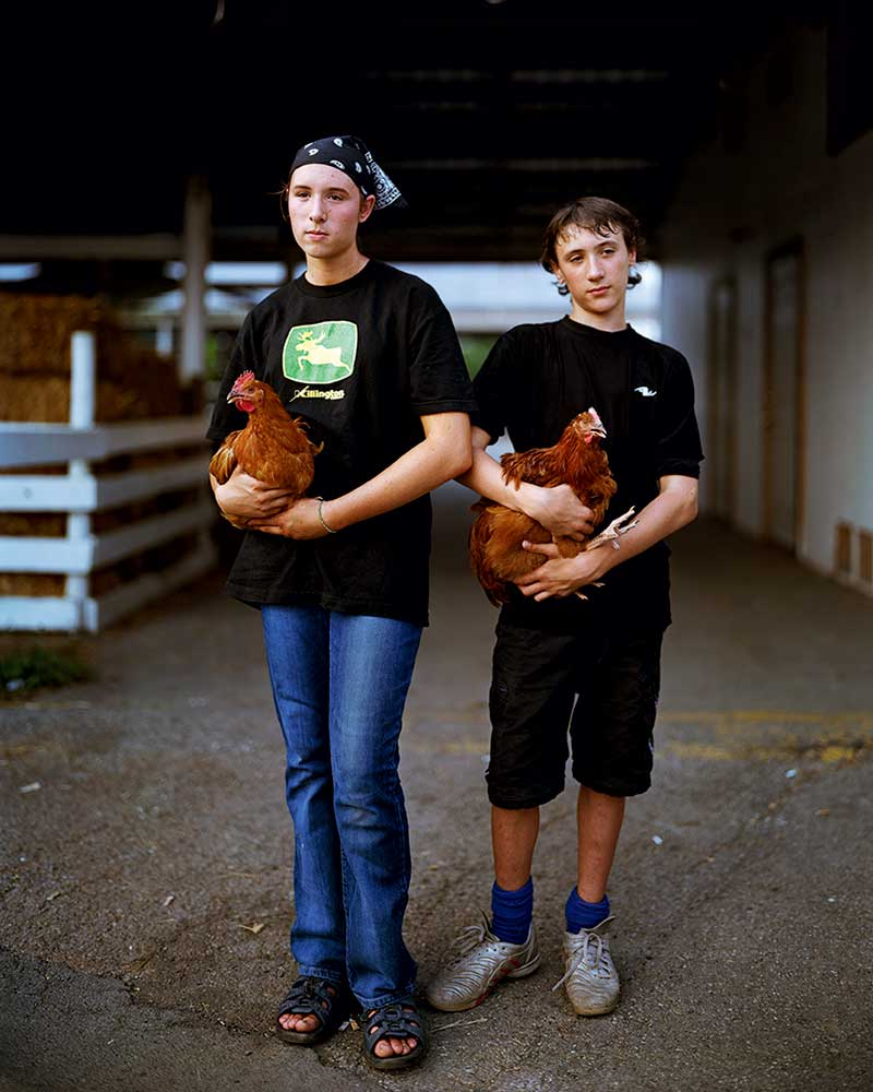 4-H siblings Amanda (left) and David Tamas (then 15 and 13, respectively) exhibited their Rhode Island Red hens at New York's Orange County Fair in 2006. She's since become a lawyer specializing in environmental issues, while he's studying veterinary medicine.
